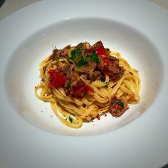 Pasta with slow cooked lamb-shanks and roasted tomatoes