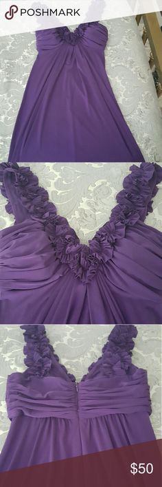 Plum bridal party dress This dress was only worn once! It is plum colored with an embroidered v neck and zipper in back! Perfect if you are attending a wedding, banquet, or any fancy outing! Reaches to about knee length or slightly higher. Dresses