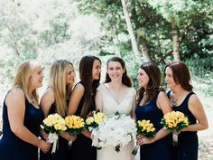 Navy bridesmaids dresses. Yellow roses and orchids.  Matthew and Theresa, Married! by Tammie Gilchrist TammieGilchristBlog.com