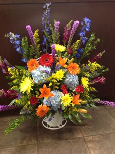 #funeral basket #colorful #mixed flowers #sympathy #hydrangea #lilies #gerbera daisies #roses #blue delphinium #floralcreations #smyrna