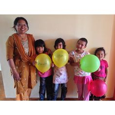 The little girls at Restore's new orphanage in Kathmandu with one of their caretakers. We love this little family!