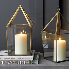 Open pyramid shines bright in antiqued brass and transparent glass with a mirrored base to reflect even more light. Hangs by metal loop or sits flat.