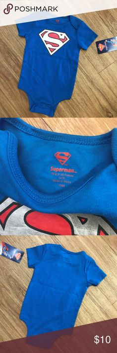"""Superman Bodysuit NEW NWT 18 Mo Blue Red Superman Bodysuit NEW NWT 18 Mo Blue Red  So sweet!  Snaps at stride.  Screenprinted shiny logo.  18"""" from midpoint of back of neck to midpoint of stride at the fold Superman One Pieces Bodysuits"""