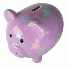 purple piggy banks | Football fans may prefer the clever Football Piggy Bank. It looks like ...