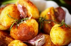 Perfect Roast Potatoes - parboil; toss in olive oil and S + P; bake at 350F for 30 minutes; toss preferred flavor combination (see site for suggestions - pictured: rosemary and garlic) with olive oil and red vinegar; smash potatoes and add flavor; bake for 40-45 more minutes until golden brown.