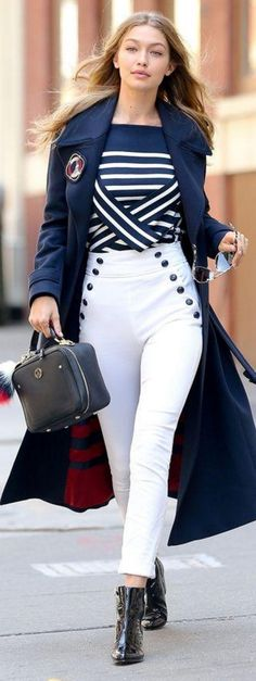 Who made  Gigi Hadid's blue coat, white stripe sweater, skinny pants, and black ankle boots?