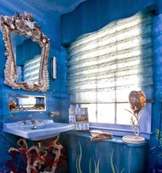 Fairy Tale under the Sea Bathroom with Shell Decor: http://www.completely-coastal.com/2014/10/under-the-sea-rooms.html