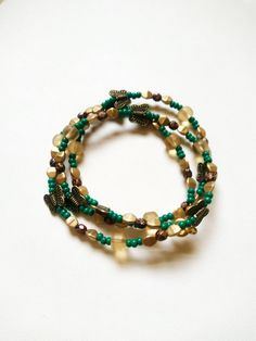 Now selling: Green Butterfly Wrap Around Bracelet with Gold Highlights Summer Style Jewelry Trendy Stackable Bracelet https://www.etsy.com/listing/510854280/green-butterfly-wrap-around-bracelet?utm_campaign=crowdfire&utm_content=crowdfire&utm_medium=social&utm_source=pinterest