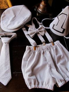 Boys Smash Cake Outfit, Boys Birthday Outfit: Bowtie, Suspenders, Neck Tie, Diaper Cover, Newsboy Hat, Party Hat. $100.00, via Etsy.