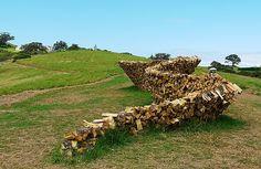 Cordwood fence sculpture on Waiheke Island, New Zealand. Photo by Angela Hemming. via inspiration green