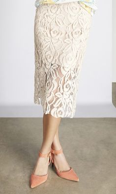 Transition easily from office to happy hour in this elegant lace pencil skirt made from sustainable fabrics.