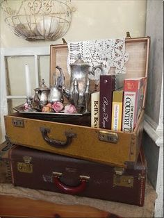 Adore the stacked, vintage suitcases; never tire of these ...