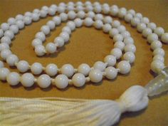 6mm Riverstone with a Clear Quartz Guru Bead, Hand Knotted on White Silk by Mother Earth Malas - Malas on Silk