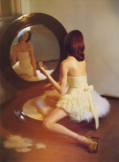 I love the giant powder compact with the girl sitting on the puff....so adorable, by Tim Walker via terrier & lobster