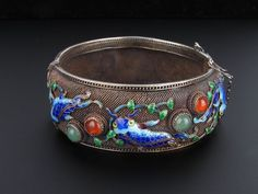 This is a fabulous Chinese sterling silver and cloisonné bangle that dates to the Art Deco era. It features beautifully detailed koi fish in brilliant shades of blues swimming amongst jade and carnelian bubbles and green cloisonné water plants. | eBay!