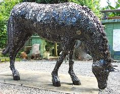 Horse Feeding, life size. Contact us at sales@steelartfactory.com for more information.