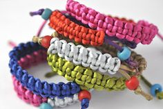 """color block bracelets hand knotted brights / vintage trade beads inspired by the master of color blocking YSL, a grown up chic """"friendship"""" bracelet."""