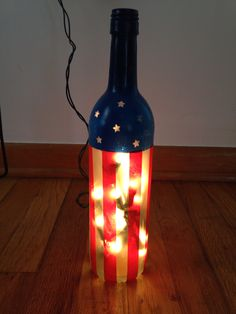 4th of July lights! Wine bottle, mini lights from $1 store, wash tape, stat stickers, blue and frost spray paints. Plus use of a drill... So easy!