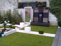 "Outdoor ""Natura Wall"" by Cactose, with natural stone and stainless steel. Find more information and create your own wall on www.mur-eau.com  copyright©Cactose CTO."