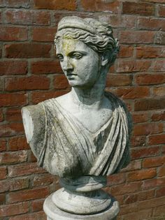 """A weathered, composition-stone bust of Athena on column. Made from a pale coloured stone composite, this is an ideal feature for a dark, heavily shaded location.  Modern  60"""" high overall (Bust 30"""" high)  £180"""