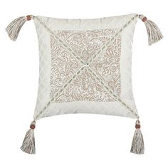 Pillow with tasseled corners and a scrolling motif accented by textural diamond borders.   Product: PillowConstruction M...