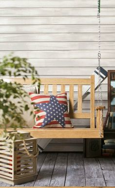 There's nothing more classic American than a porch swing with a red white and blue pillow. Livin' the dream.
