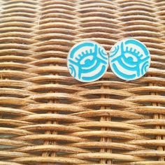 Adinkra God's eye studs via Sarah Juanita Creates. Click on the image to see more!