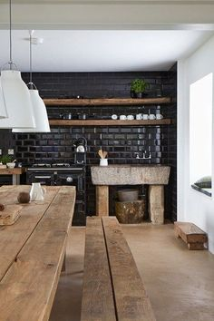 Love the stone bench! Kitchen. Black tiles.