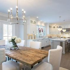 The new white kitchen: grey walls, French doors, salvaged rustic wood dining table, white or grey kitchen island, white marble countertops, marble subway tiled backsplash. Simple beauty.