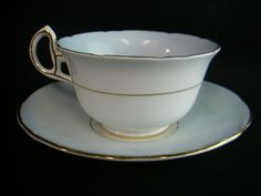 """The approximate diameter of the saucer is 5½"""". The cup and saucer each have on the bottom a """"Made in England"""" and Royal Stafford mark. I ALWAYS list the item with as much information as I have available. 