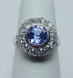 A sapphire wedding ring for love and loyalty and tradition. And a little Art Deco influence never hurt nobody. ;)