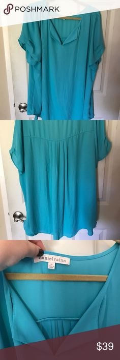 "Gorgeous blue Nordstrom blouse!!! 💎💎 Pretty short sleeve blouse from Nordstrom! Quality Daniel Rainn brand. Polyester fabric. Perfect for work or out. Flattering. True to size. Color is turquoise blue. Classy.🌹 Buy 2 or more and get 15% of bundle!!!🌹w:27"", l: 32"" Daniel Rainn Tops Blouses"