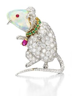 Verdura. A 'Mouse' Brooch Designed of Opal, Diamonds, Emeralds and Rubies, by Verdura,  circa 1950.  Previously in the Collection of Babe Cushing Paley. Available Exclusively at FD. www.fd-inspired.com