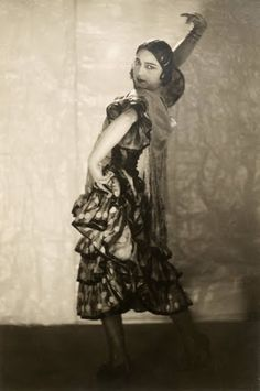 "A flamenco dancer in Picasso's Asturian flour-maker's costume from Manuel de Falla's 1919 ballet, ""The Three-Cornered Hat,"" which was commissioned for the Ballets Russes."