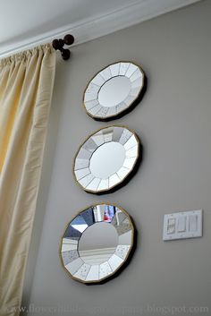 The mirrors are from Ballard Design, they are called Bellesol Mirrors.  This grouping was a photo on the blog Flower Hill Design.  I've never been a huge fan of decorative mirrors, but I really like these.