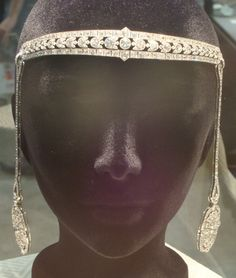The Cartier Bandeau was created in the Cartier Paris House in 1920.  The 58 carats of diamonds set in platinum converts to a choker, earrings, bracelet, lapel clip pins and pendant drop.