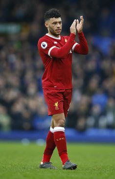 Alex Oxlade-Chamberlain of Liverpool shows appreciation to the fans following the Premier League match between Everton and Liverpool at Goodison Park on April 7, 2018 in Liverpool, England.
