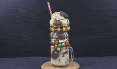 Ingredients: 1 Snickers 2 scoops Ice cream 250 ml Cold Milk Nutella M&M's 2 Doughnuts 1 Waffle 1 Oreo Sprinkles Maple Syrup Preparation: Blend the snickers with 2 Maple Syrup, Doughnuts, Milkshake, Nutella, Wind Chimes, Oreo, Sprinkles, Waffles, Food And Drink