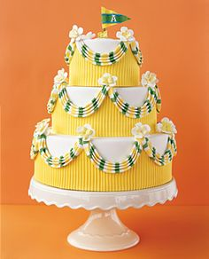 Preppy, yacht-club inspired confection with striped bunting and a monogrammed pennant