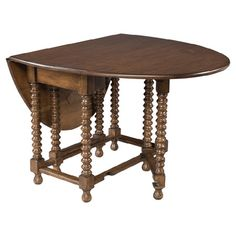 Walnut table with a turned gate-leg design featuring 2 drop leaves.   Product: TableConstruction Material: Waln...