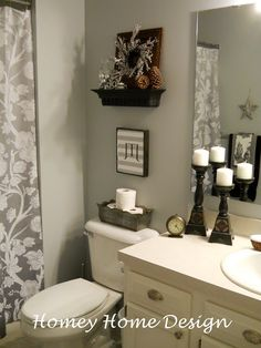 shower curtain, light grey walls in small bathroom
