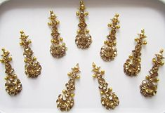 Gold Long Bindis Face Jewels * can be wear on any party *best quality ready to be use *size:(L) cm (W) cm (from bottom) Third Eye Piercing, Face Jewels, Best Part Of Me, Adhesive, Bollywood, Glow, Drop Earrings, Stickers, Stone