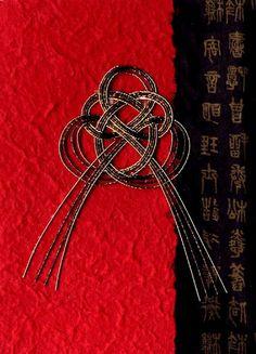 elegant use of mizuhiki knot in vibrant red, black and gold...