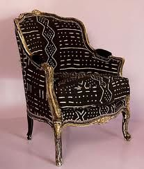 African mudcloth chair.  Hand woven and hand-dyed mudcloth uses a centuries old process using numerous applications of various plant juices/teas and mud to dye hand woven cotton cloth