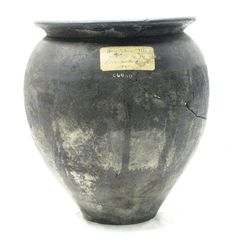 This olla or urn is made of Upchurch ware, produced by the kilns of Upchurch marshes in Kent. Vessels like this could be used for cooking, food storage, or as in this case as a burial urn for cremation ashes.