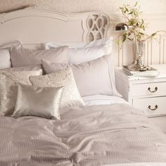 Zara Home - white furniture with shades of grey and beige with gold accent pieces