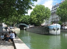 Strolling along the Canal Saint-Martin, which runs from the Place de la Republique to the Place de la Bastille de Stalingrad, is a very pleasant experience. The canal was constructed in the early 1800s to ease barge traffic on the Seine and bring drinking water into Paris. Today, it's just a lovely place to hang out. On Sundays, the Quai de Valmy and Quai de Jemmapes, streets paralleling the canal, lined with Chestnut and Plane trees, are open only to pedestrian and bike traffic.
