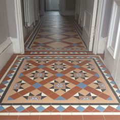 Gorgeous Blenheim Pattern with bespoke border in the vestibule with bespoke simplified version in the hall. Tiles from the Victorian Floor Tile Collection at Welby  Wright. Installed by Welby  Wright.