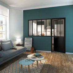Envie d'une cuisine fermée sans pour autant l'isoler du salon ? Optez pour cette élégante verrière, composée d'une partie fixe à la manière des ateliers d'artiste, et