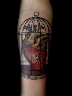 Caged Heart Tattoo by David Rudzinski  Only I want a pretty heart instead of anatomical